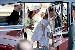 The Duchess of Cambridge with Prince George and Princess Charlotte leaving St George's Chapel in Windsor Castle after the wedding of Prince Harry and Meghan Markle.