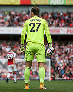 Bournemouth goalkeeper Asmir Begovic holds a punctured burst football in his hand. Premier league match, Arsenal v AFC Bournemouth at the Emirates Stadium in London on Saturday 9th September 2017. pic by Kieran Clarke, Andrew Orchard sports photography.