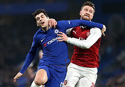 10 January 2018 - Football League Cup - Chelsea v Arsenal - Shkodran Mustafi of Arsenal drags Alvaro Morata of Chelsea to the floor to give away a free kick - Photo: Charlotte Wilson / Offside