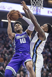December 31, 2017 - Sacramento, CA, USA - The Sacramento Kings' Frank Mason III (10) is fouled by the Memphis Grizzlies' Mario Chalmers on Sunday, Dec. 31, 2017, at the Golden 1 Center in Sacramento, Calif. (Credit Image: © Hector Amezcua/TNS via ZUMA Wire)