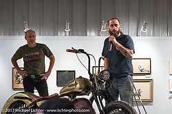 Custom builder Terrence Musto talks about his unique softail design of his Shovelhead chopper on display in the Old Iron - Young Blood exhibition during the media and industry reception in the Motorcycles as Art gallery at the Buffalo Chip during the annual Sturgis Black Hills Motorcycle Rally. Sturgis, SD. USA. Sunday August 6, 2017. Photography ©2017 Michael Lichter.