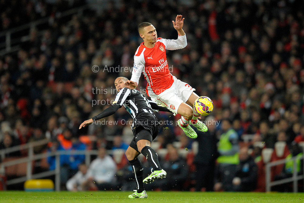Yoan Gouffran of Newcastle United challenges  Kieran Gibbs of Arsenal. Barclays Premier league match, Arsenal v Newcastle Utd at the Emirates Stadium in London on Saturday 13th December 2014.<br /> pic by John Patrick Fletcher, Andrew Orchard sports photography.