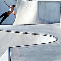 An unhelmeted skater climbs the wall of one of the bowls at the Scotts Valley Skate Park.<br /> Photo by Shmuel Thaler <br /> shmuel_thaler@yahoo.com www.shmuelthaler.com
