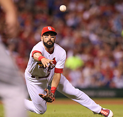 September 26, 2017 - St Louis, MO, USA - St. Louis Cardinals first baseman Matt Carpenter tosses to a teammate covering first as the Chicago Cubs' Mike Freeman reaches safely with a single in the fourth inning on Tuesday, Sept. 26, 2017, at Busch Stadium in St. Louis. The Cards won, 8-7. (Credit Image: © Chris Lee/TNS via ZUMA Wire)