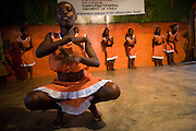 Members of the Liberian Dance Troupe (LDT) perform traditional dancing at the Buduburam refugee settlement, roughly 20 km west of Accra, Ghana's capital, on Saturday April 14, 2007. One of the main goals of the LDT is to teach young refugee children, many of which have never seen Liberia, about their country's music, dance and culture. The Buduburam refugee settlement is still home over 30,000 Liberians, most of which have mixed feelings about returning to Liberia.