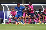 AFC Wimbledon Kane Crichlow (31) battles for possession during the Pre-Season Friendly match between AFC Wimbledon and Queens Park Rangers at the Cherry Red Records Stadium, Kingston, England on 14 July 2018. Picture by Matthew Redman.
