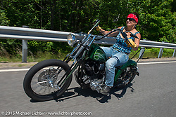 """How is this for having a lawya that gets bikers! Rene Brown with """"Not Guilty"""" tattooed across her back on her very cool Panhead bobberis pretty darn cool! At the Broken Spoke during Laconia Motorcycle Week. NH, USA. June 19, 2014.  Photography ©2014 Michael Lichter."""