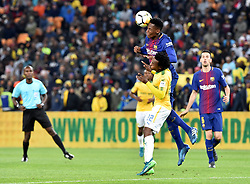 Mamelodi Sundowns player Percy Tau and Barcelona FC player Yerri Mina battle for the ball during Mandela Centenary Cup at FNB stadium, Gauteng.<br />Picture: Itumeleng English/African News Agency (ANA)