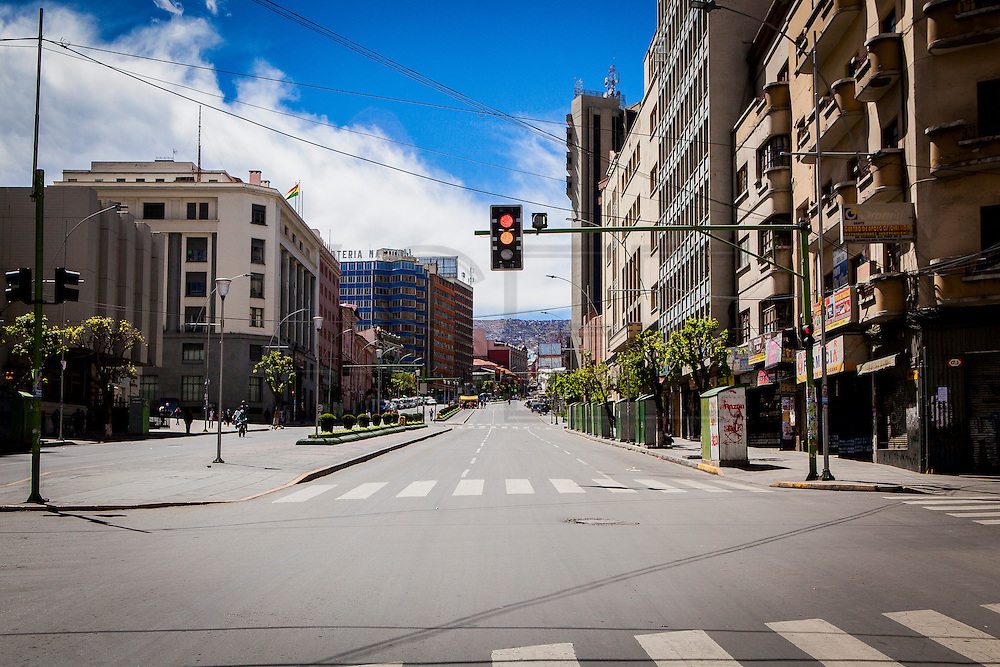 16th Avenue in central La Paz. During a normal the avenue will be full of vehicles since it is one of the main arteries of La Paz. During elections period in  Bolivia, the country faces several restrictions, like no alcohol for sale 48 hours before and 12 after the election; no public gatherings, shows of any kind until the political parties made their speeches on the election night; its completely forbidden the circulation of any vehicles, private or governmental except with the permit from the Electoral Tribunal, which means it would be basically no cars, buses or anything circulating in the city; no long distance buses, the terminal will be close from Saturday until Monday and even flights will not be allowed except the ones leaving the country or the international ones doing stop-over. It is a completely shut down of the country.