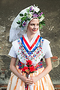 Tinais wearing the Traditional Sorbian Bridesmaid Costume in Saspow near Cottbus, Germany on June 9, 2017.<br /> <br /> The so called 'Brautjungfer' is dressed the most colourful, because she is still looking for a husband. Tina is wearing the Traditional Sorbian Bridesmaid Costume in Saspow near Cottbus, Germany on June 9, 2017.<br /> <br /> The so called 'Brautjungfer' is dressed the most colourful, because she is still looking for a husband.