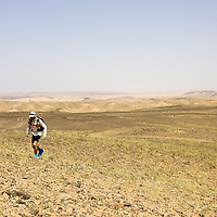 25 March 2007: Runner #499 Andrew Cohen of Australia runs across a blooming desert because of a rainy winter between Irhs and Khermou during the first stage of  the 22nd Marathon des Sables, a 6 days and 151 miles endurance race with food self sufficiency across the Sahara Desert in Morocco. Each participant must carry his, or her, own backpack containing food, sleeping gear and other material.