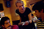 A Czech woman serves two young men, the Beer museum, central Prague, Czech Republic. .