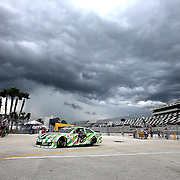 Kyle Busch returns to the garage area due to a thunderstorm during the first practice session of the 56th Annual NASCAR Coke Zero400 race at Daytona International Speedway on Thursday, July 3, 2014 in Daytona Beach, Florida. (AP Photo/Alex Menendez)