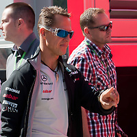 Mercedes Formula One driver Michael Schumacher of Germany arrives to the paddock before the free testing session of