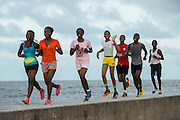 Joggers on Sea Wall<br /> Georgetown<br /> GUYANA<br /> South America<br /> Built by Dutch, Georgetown is below sea level