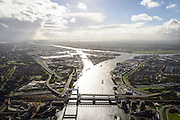 Nederland, Zuid-Holland, Dordrecht, 23-10-2013; spoorbrug over de Oude Maas , bijnaam Het Hemelbed, splitsing met Dordsche Kil (naar links, richting Hollandsch Diep). Daarnaast de Stadsbrug, waarvan de verkeersstroom tegenwoordig door de Drechttunnel gaat.<br /> railway bridge, road bridge and road tunnel of the Oude Maas in Dordrecht<br /> luchtfoto (toeslag op standaard tarieven);<br /> aerial photo (additional fee required);<br /> copyright foto/photo Siebe Swart.