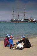 Family on beach at Aquatic Park, San Francisco, California