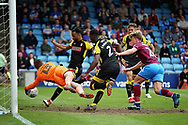Rotherham United goalkeeper Marek Rodak (13) can't keep out a shot from Scunthorpe United's Cameron McGeehan(26)  during the EFL Sky Bet League 1 match between Scunthorpe United and Rotherham United at Glanford Park, Scunthorpe, England on 12 May 2018. Picture by Nigel Cole.