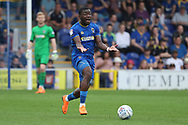 AFC Wimbledon defender Deji Oshilaja (4) dribbling and making gesture with his hands during the EFL Sky Bet League 1 match between AFC Wimbledon and Oldham Athletic at the Cherry Red Records Stadium, Kingston, England on 21 April 2018. Picture by Matthew Redman.