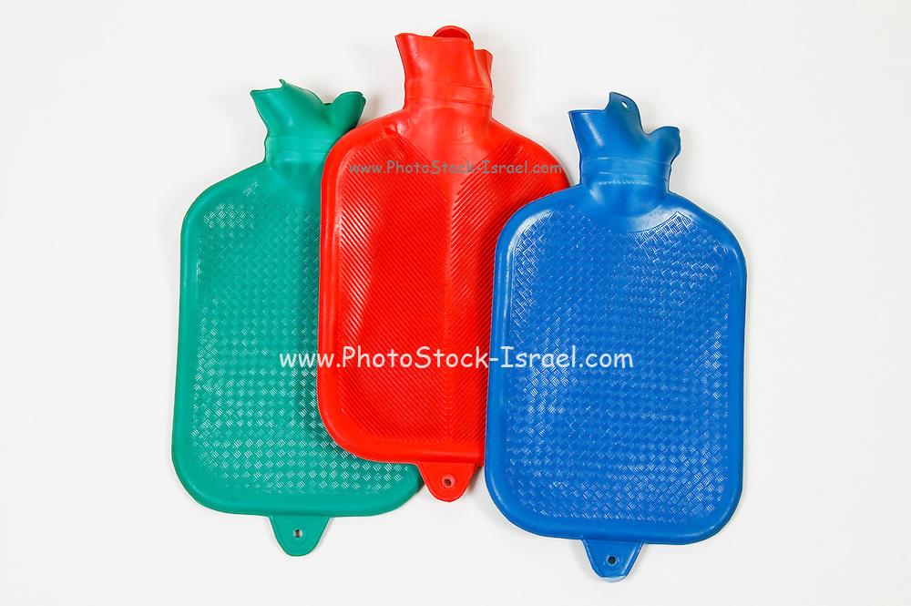 Three hot water bottles on white background