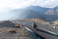 Biltwell photographer Geoff Kowalchuk riding smooth mountain curves up to Muktinath in Motorcycle Sherpa's Ride to the Heavens motorcycle adventure in the Himalayas of Nepal. On the fourth day of riding, we went from Kalopani to Muktinath. Thursday, November 7, 2019. Photography ©2019 Michael Lichter.