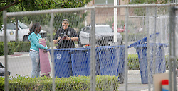 August 7, 2017 - Tustin, CA, USA - Officer Crouch helps Alena Clayton, 47, inventory her belongings for storage at the civic center in Tustin, CA on Monday, August 7, 2017. The city posted signs at the civic center telling people living in the homeless encampment that they must move out by 8 a.m. to make way for a temporary library. (Credit Image: © Ken Steinhardt/The Orange County Register via ZUMA Wire)