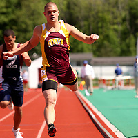 Clymer's Nick Lambardozzi cross the finush in the 100 meters dash 5-30 photo by Mark L. Anderson