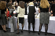 Female employees help themselves to a buffet lunch at their corporate rally day, held for 3,000 UK staff at Excel