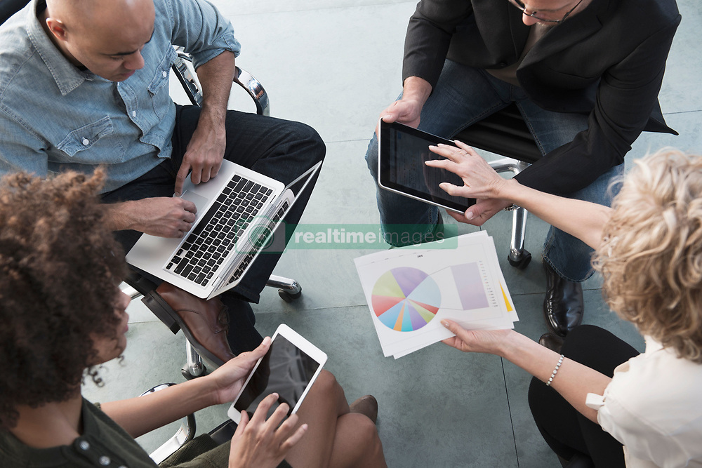 Business people talking in office (Credit Image: © Image Source/Jose Pelaez/Image Source/ZUMAPRESS.com)