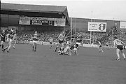 Kerry player falls to the ground with the ball during the All Ireland Senior Gaelic Football Championship Final Kerry v Dublin at Croke Park on the 22nd September 1985. Kerry 2-12 Dublin 2-08.