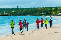 Members of a soccer team jogging along the beach, Chateaubriand Bay, We, Lifou (island), Loyalty Islands, New Caledonia