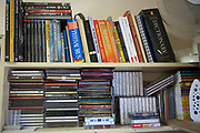 Books and CD's on a shelf in a prisoners cell at HMP Kingston. Portsmouth, United Kingdom. Kingston prison is a category C prison holding indeterminate sentenced prisoners.