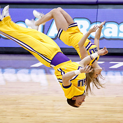 November 23, 2011; Baton Rouge, LA; LSU Tigers cheerleaders perform a flip on the court during a break in the action in the second half of a game between the LSU Tigers and the South Alabama Jaguars at the Pete Maravich Assembly Center. South Alabama defeated LSU in overtime 79-75. Mandatory Credit: Derick E. Hingle-US PRESSWIRE