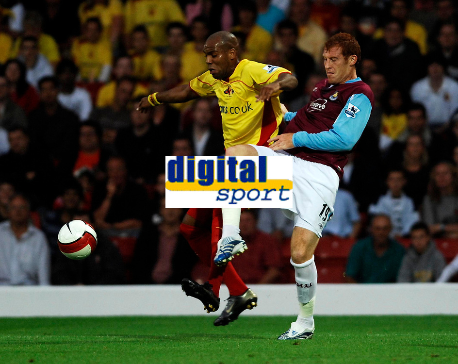 Photo: Richard Lane.<br />Watford v West Ham United. The Barclays Premiership. 22/08/2006. Watford's Marlon King is challenged by West Ham's James Collins.
