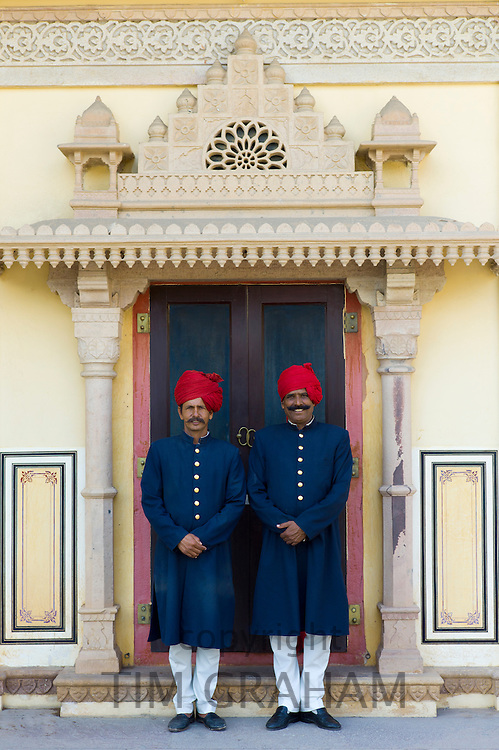 Palace guards in achkan suit at former Royal Guest House in the Maharaja's Moon Palace in Jaipur, Rajasthan, India