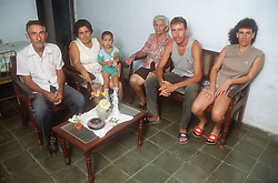 Family and neighbours sitting together in apartment in Gibara; Holguin province; Cuba,