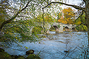 Ancient LLangynidr Bridge road bridge with arches across River Usk flowing in the Brecon Beacons, Powys, Wales, UK