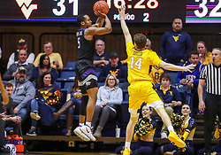 Feb 18, 2019; Morgantown, WV, USA; Kansas State Wildcats guard Barry Brown Jr. (5) shoots a three pointer during the second half against the West Virginia Mountaineers at WVU Coliseum. Mandatory Credit: Ben Queen-USA TODAY Sports