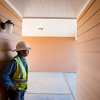 101513       Brian Leddy<br /> Harold Mann, a worker with Souers Construction, stands in the entryway to a newly remodeled home in Crownpoint Tuesday. The Navajo Housing Authority recently renovated the home.
