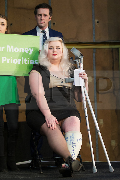 """© Licensed to London News Pictures . 15/04/2016 . Manchester , UK . A woman with """" BREXIT """" written on her plaster cast watching Boris Johnson speak at a """" Vote Leave """" rally at Old Granada Studios , in Manchester . Photo credit: Joel Goodman/LNP"""