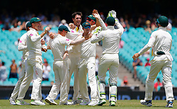 Australia's Pat Cummins celebrates the wicket of England's Stuart Broad during day five of the Ashes Test match at Sydney Cricket Ground.