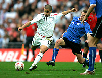 Photo: Tom Dulat.<br /> England v Estonia. UEFA European Championships Qualifying. 13/10/2007.<br /> Aleksandr Dimitrijev of Estonia and Joe Cole of England with the ball.