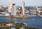 View looking over the city centre from the 185 metre tall Euromast tower, Rotterdam, Netherlands towards Hotel New York surrounded by skyscrapers