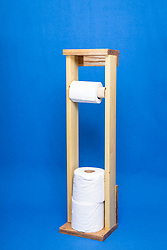 toilet tissue or toilet paper on a portable holder made of wood
