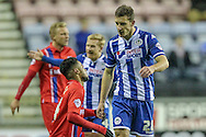 Bradley Dack (Gillingham) fouled by Jason Pearce (Wigan)  during the Sky Bet League 1 match between Wigan Athletic and Gillingham at the DW Stadium, Wigan, England on 7 January 2016. Photo by Mark P Doherty.