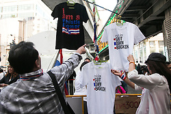 © Licensed to London News Pictures. 05/01/2014. Anti-Government protestor points at an 'Shut Down Bangkok' T-shirt during the third day of the 'Bangkok Shutdown' as anti-government protesters continue with their 'shutdown' of Bangkok.  Major intersections in the heart of the city have been blocked in their campaign to oust Prime Minister Yingluck Shinawatra and her government in Bangkok, Thailand. Photo credit : Asanka Brendon Ratnayake/LNP