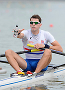 Chungju, South Korea. GBR LM1X, Jamie KIRKWOOD, at the start of his heat,  pours water over himself, before racing. 2013 FISA World Rowing Championships, , Tangeum Lake International Regatta Course. 10:18:50  Sunday  25/08/2013 [Mandatory Credit. Peter Spurrier/Intersport Images]