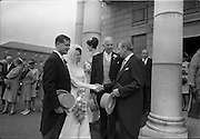 05/07/1967<br /> 07/05/1967<br /> 05 July 1967<br /> Wedding of George Walsh, eldest son of Mr and Ms Kevin G. Walsh, St. Rita's, Firhouse Road, Templeogue, Co. Dublin and Miss Arlene McMahon, elder daughter of Det. Chief Supt. Philip McMahon, Head of Special Branch, Dublin Castle and Mrs McMahon of Lisieux, Templeville Park, Templeogue, Co. Dublin who were married at the Carmelite Church, Terenure College, Dublin. An Taoiseach Mr Jack Lynch and Mrs Lynch; Mr Liam Cosgrave, leader Fine Gael and Mrs Cosgrave were among the 120 guests. Rev Fr H.E. Wright, O. Carm., Moate, officiated at the ceremony. The reception was held at Downshire Hotel, Blessington, Co. Wicklow. Picture shows Bride and room being congratulated by Mr Lynch, with Philip McMahon in centre.