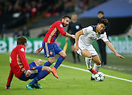 Tottenham's Heung Min-Song tussles with CSKA Moscow's Zoran Tosic during the Champions League group match at Wembley Stadium, London. Picture date December 7th, 2016 Pic David Klein/Sportimage