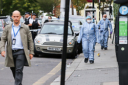 © Licensed to London News Pictures. 22/09/2019. London, UK. Forensics officers and a police detective on Langham Road in North London near Turnpike Lane underground and bus station where three men were stabbed and rushed to hospital. Met police were call shortly after 4pm this afternoon to Langham Road and found three men suffering from stab wounds. According to the Met Police, two men have been arrested on suspicion of GBH. Photo credit: Dinendra Haria/LNP